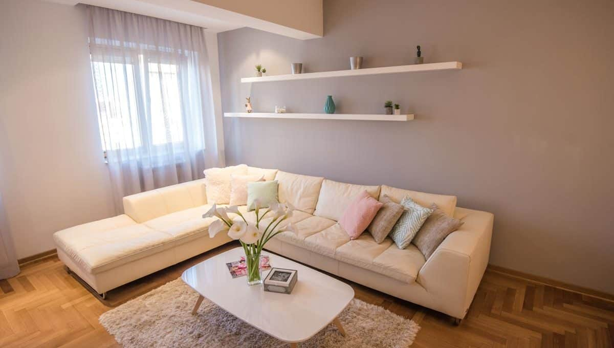 Apartment Boulevard white couch with colorful pillows