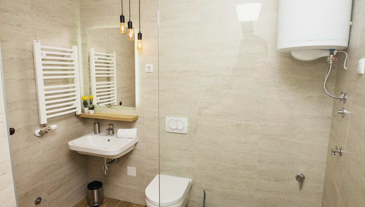 Apartment A14 bathroom with glass shower cabin