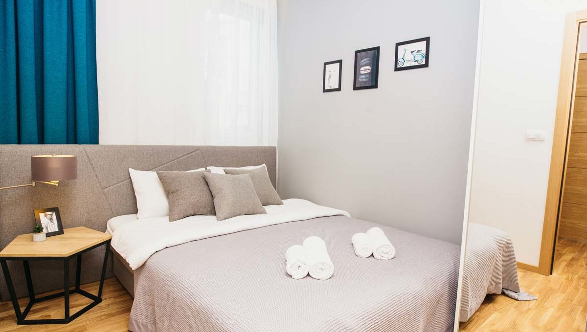 Apartment A17 bedroom with grey double bed