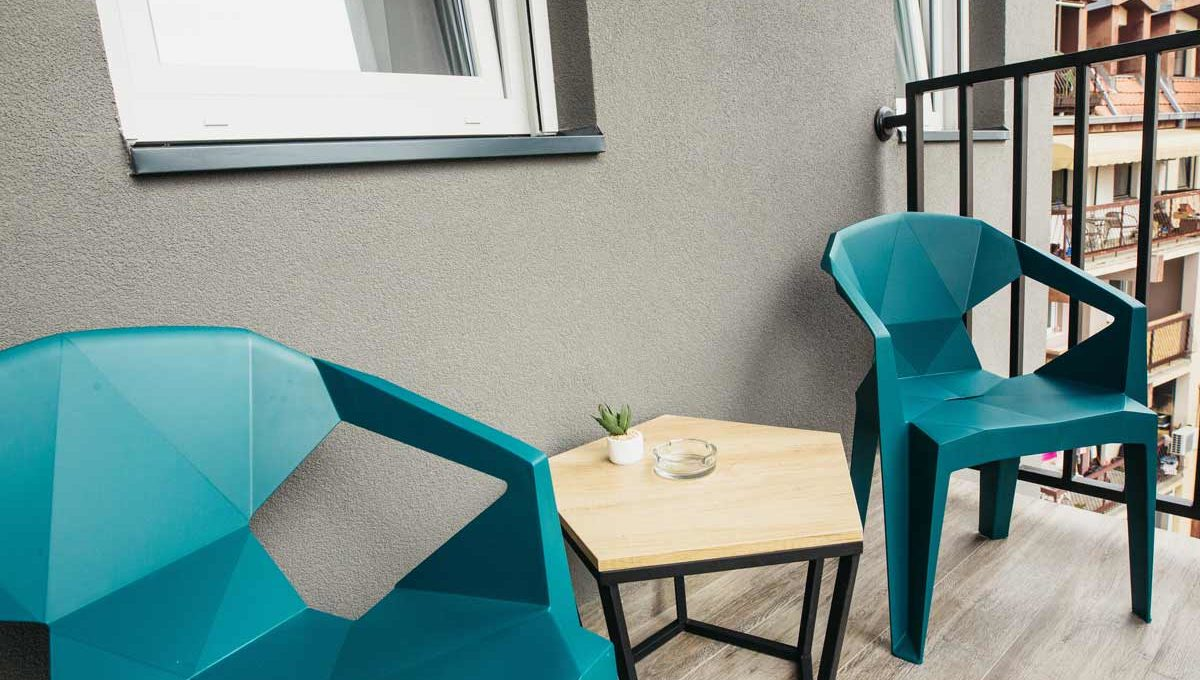 Apartment A17 terrace with blue chairs